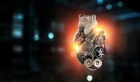 Anatomic heart made with gears and mechanic parts. Anatomic heart model made with gears and mechanic parts, digital board background stock illustration