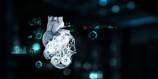 Anatomic heart made with steel gears and mechanic parts. Anatomic heart model made with gears and mechanic parts, digital board background royalty free stock images