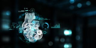 Anatomic heart made with steel gears and mechanic parts. Anatomic heart model made with gears and mechanic parts, digital board background royalty free stock photos
