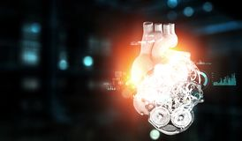 Anatomic heart made with steel gears and mechanic parts. Anatomic heart model made with gears and mechanic parts, digital board background stock photography