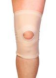Anatomic knee joint orthosis on leg. Elastic compression bandage Royalty Free Stock Photos