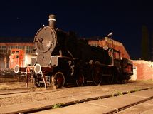 Railway locomotive section. Freight locomotive in the section of the museum in Skierniewice in night scenery Royalty Free Stock Image