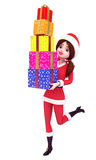 Anatomy of santa girl is carrying lots of gifts Stock Image