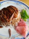 Anatra di arrosto sopra riso Fotografie Stock