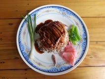 Anatra di arrosto sopra riso Fotografia Stock Libera da Diritti