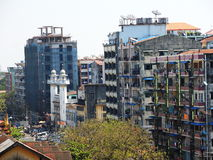 Anawratha Rd. in Yangon with Bammalar mosque. Anawratha Rd. (Yangon), with old and new building at 54th Rd.. And a lot of laudnry at balconies. Dec Royalty Free Stock Photos
