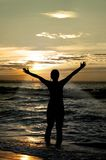 Anbeter gegen Sonnenuntergang Stockfotografie