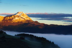 Anboto mountain in foggy Aramaio valley. At sunrise Stock Images