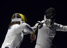 Anca Maroiu. Romanian Fencer Anca Maroiu pictured in action during her game against Ana Maria Branza counting for the Romanian National Women Fencing Stock Photography