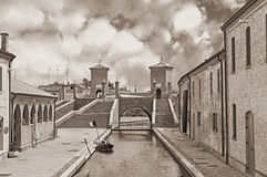 Ancent bridge in Comacchio, Italy. The antique bridge Trepponti, a famous five-way bridge in Comacchio, Ferrara, Italy - black and white image in sepia tone Stock Image