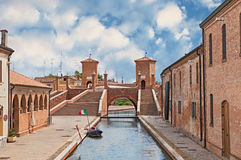Ancent bridge in Comacchio, Italy. The old bridge Trepponti, a famous five-way bridge in Comacchio, Ferrara, Italy Royalty Free Stock Photography