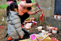 Ancestor veneration in China. Ancestral veneration in Chinese cultures,as well as ancestor worship,seeks to honor and reminiscence the actions of the deceased royalty free stock photography
