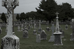 Ancestors. Weathered gravestones stand watch at a cemetery in western Ireland Stock Image