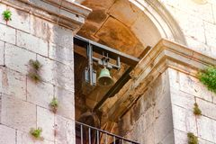 Ancestral bell tower and a bell in an old church, a church illuminated by the sun stock photography