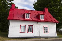 Ancestral house with red tin roof in Saint-Jean, Island of Orleans, Quebec royalty free stock photo