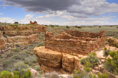Ancestral Puebloan ruins. Ruins of an Ancestral Puebloan settlement, Box Canyon dwellings, Wupatki National Monument, Arizona. Lomaki Pueblo is visible on the Royalty Free Stock Photography
