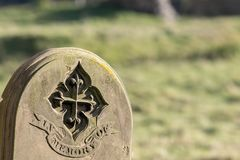 Ancestry and genealogy. Ancient gravestone inscribed with in memory of. Tracing a family tree using old cemetery headstones. Grave yard stone engraving stock images