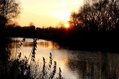 Anche, il tramonto sopra l'acqua Fotografia Stock