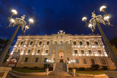 Anchieta Palace Vitoria. The facade of the historical yellow Anchieta Palace at night framed by two street lights Royalty Free Stock Images