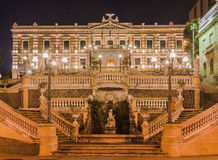 Anchieta Palace Vitoria. The facade of the historical yellow Anchieta Palace at night framed by two street lights Stock Image