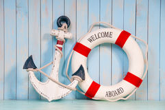 Free Anchor And Life Buoy On A Background Of Shabby Wall Boards Stock Image - 36464761