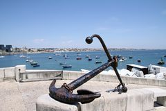 Anchor on background fishing harbor in Cascais Stock Photos