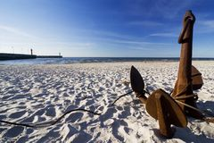 The anchor on the beach Stock Photography