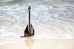 Anchor on the beach Stock Photography