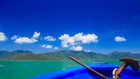 Anchor on blue boat nose drifting fast towards tropical island. Anchor on blue boat nose drifting fast towards distant green tropical island along tranquil azure stock footage