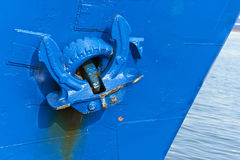 Anchor on blue ship in harbour. On a calm day Stock Image