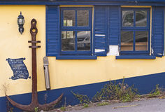 Anchor and blue shutters Royalty Free Stock Image