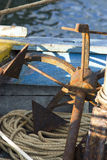Anchor on boat. Old rusty anchor on boat with rope Stock Photo