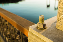 Anchor Bolt. At The Pier During Sunset/Sunrise Royalty Free Stock Images