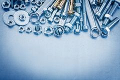 Anchor bolt washers screwbolts nuts and flat spanner on metallic Royalty Free Stock Photography
