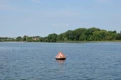 Anchor buoys specify borders on the lake. Anchor buoys specify borders on the big lake royalty free stock photo
