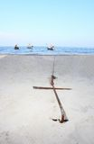 Anchor buried on the beach f Stock Images