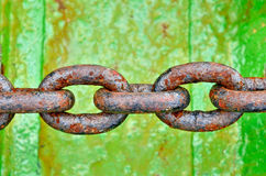 Anchor Chain. Rusty rings of anchor chain on the green floor royalty free stock photo