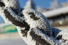 Link of an anchor steel chain in a winter snowy frost royalty free stock photography