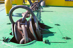 Anchor chain disappearing into the hold. Which is part of the mooring system of the ship Royalty Free Stock Images
