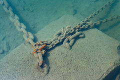 Anchor chain underwater in the sea Stock Photos