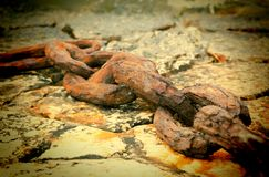 Anchor chain of a vessel on a mooring selective focus.  stock photos