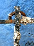 Anchor cross. Close up of the anchor cross, it's rusty and has many sea fossils Royalty Free Stock Photo