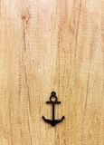 Anchor decor on the wooden background Stock Images