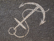 Anchor design. In stone pavement Stock Photography
