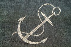 Anchor design in a cobbled sidewalk. Royalty Free Stock Photos
