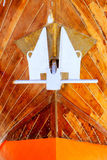 Anchor detail in silver color on a wooden hull Royalty Free Stock Photography