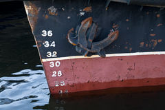 Anchor and draft scale numbering. Bow of the cargo ship with anchor and draft scale numbering Royalty Free Stock Photography