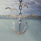Anchor dropping into water Royalty Free Stock Photography