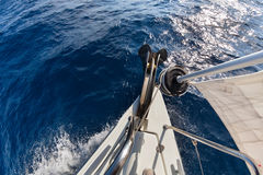 Anchor, forestay and furling drum on the yacht. Bow in sea Royalty Free Stock Photos
