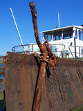 Anchor in front of a boat. An old anchor in the harbor of Flensburg stock photo
